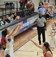 Veribest's Callie Briley, left, shoots a 3-point goal in the first over the Hermleigh defense. Veribest won the Region II-1A championship game 27-25 on Saturday, Feb. 29, 2020, at ACU's Moody Coliseum.