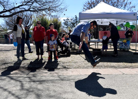 Taris Hawkins covers about half of the 14-foot jumping distance of a Goliath frog during Saturday's Leap Day event at the Abilene Zoo. The zoo celebrated February's extra day by showing off various frogs in their collection and giving visitors a chance to match the Goliath's leap.