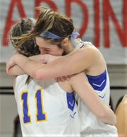 Veribest's Cora Blackwell (11) celebrates with Zoe Bratcher after the Lady Falcons' 27-25 victory over Hermleigh in the Region II-1A championship game Saturday, Feb. 29, 2020, at ACU's Moody Coliseum.