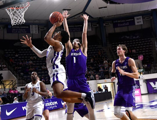 Coryon Mason goes up for the basket against Central Arkansas' Rylan Bergersen during Abilene Christian University's home game Saturday at Moody Coliseum.
