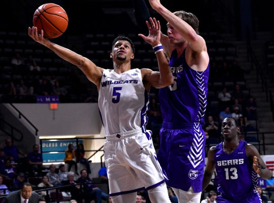 ACU guard Payten Ricks drives against Central Arkansas center Hayden Koval during the Feb. 29 game at Moody Coliseum.