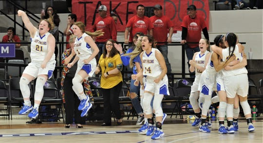 Veribest players celebrate their 27-25 victory over Hermleigh in the Region II-1A championship game Saturday, Feb. 29, 2020, at ACU's Moody Coliseum.