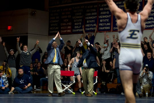 The Essex corner celebrates the win by Luke Williams at 145 pounds during the Vermont high school wrestling championships in Bennington on Saturday, Feb. 29, 2020.
