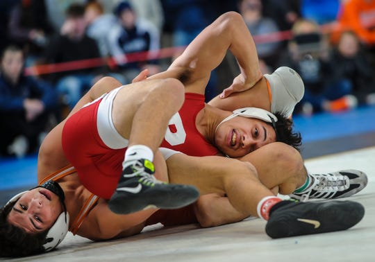Jacob Perez-Eli of Paulsboro, right, tangles with Cooper Pontelando of Cherokee in their 138-pound match in the finals of the NJSIAA Region 7 wrestling championships at RWJBarnabas Health Arena in Toms River on Feb. 29, 2020.