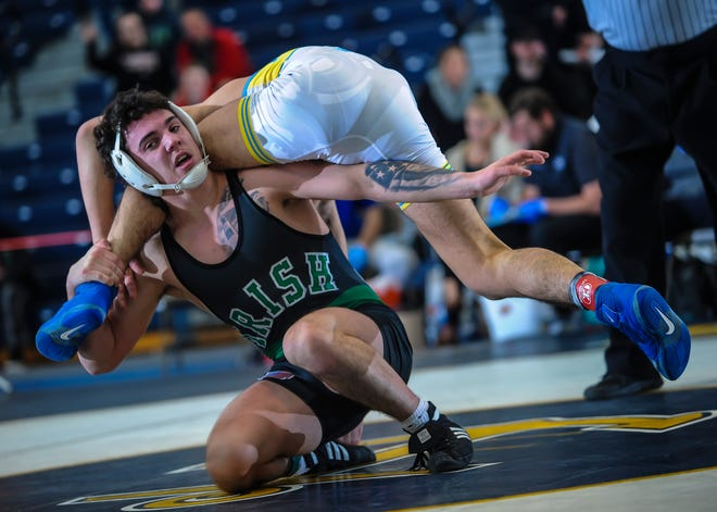 Brandon Mooney of Camden Catholic works to score points against Nick Boggiano of Toms River North in their 152-pound match in the finals of the NJSIAA Region 7 wrestling championships at RWJBarnabas Health Arena in Toms River on Feb. 29, 2020.