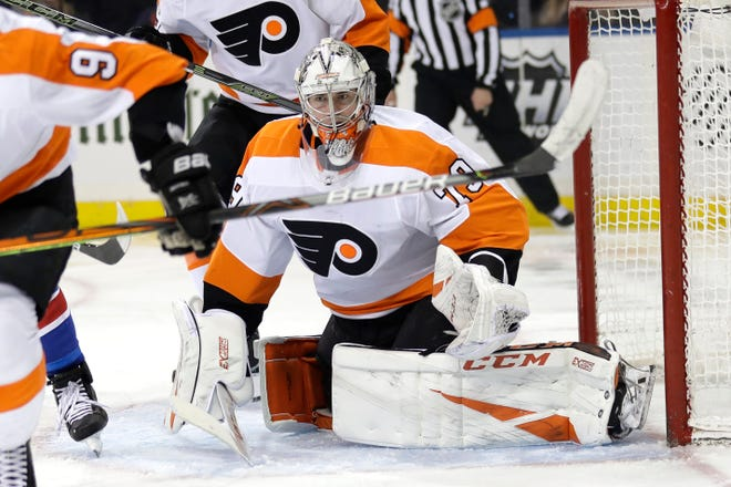 Philadelphia Flyers goaltender Carter Hart watches the puck during the second period Sunday.