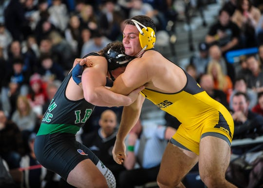 Robert Damerjan of Moorestown, right , grapples with Hunter Suter of Camden Catholic in their 220-pound match in the finals of the NJSIAA Region 7 wrestling championships at RWJBarnabas Health Arena in Toms River on Feb. 29, 2020.