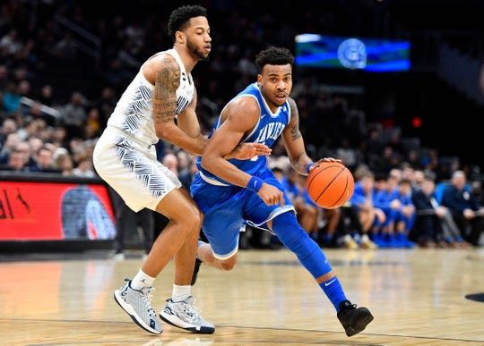 Mar 1, 2020; Washington, District of Columbia, USA; Xavier Musketeers guard Paul Scruggs (right) dribbles against Georgetown Hoyas guard Jahvon Blair (left) during the first half at Capital One Arena.