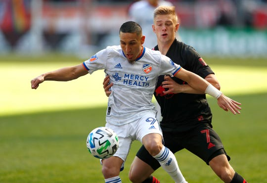 Mar 1, 2020; Harrison, New Jersey, USA;  FC Cincinnati defender Adrien Regattin (9) plays the ball against New York Red Bulls defender Patrick Seagrist (7) during the first half at Red Bull Arena.