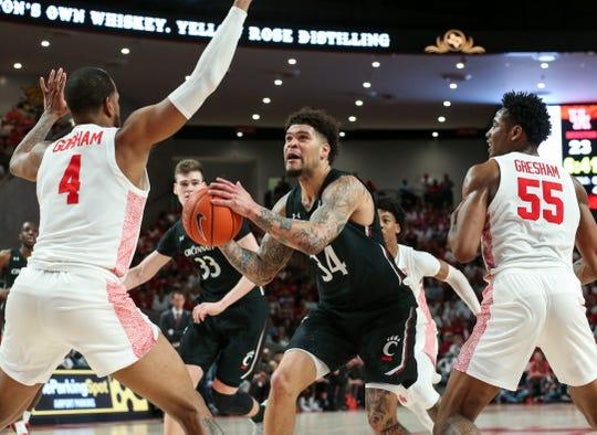 Mar 1, 2020; Houston, Texas, USA; Cincinnati Bearcats guard Jarron Cumberland (34) drives to the basket against Houston Cougars forward Justin Gorham (4) during the first half at Fertitta Center.