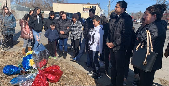 Family and friends of Mauricio Ruiz Quintana, 26, and Brayan Martinez Ruiz, 22, pray Feb. 29 while placing a memorial at Southwest Ninth and Marion streets, near where the two men were killed in a fatal crash.