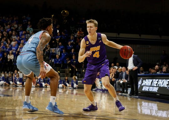 Northern Iowa sophomore AJ Green moves the ball inside as he is guarded by Drake senior Anthony Murphy in the first half at the Knapp Center in Des Moines on Saturday, Feb. 29, 2020.