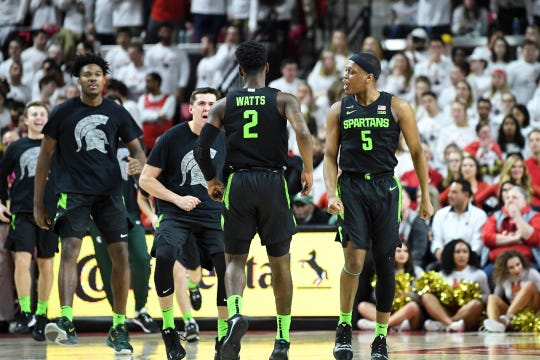Michigan State's Cassius Winston, right, and teammates celebrate a 3-pointer made by Rocket Watts during the first half against Maryland, Saturday, Feb. 29, 2020, in College Park, Md.