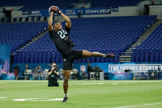 Ohio State defensive back Jeff Okudah makes a catch during a workout drill at the NFL combine at Lucas Oil Stadium in Indianapolis, March 1, 2020.