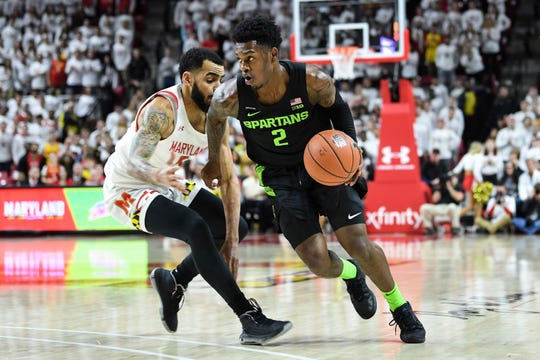 Michigan State guard Rocket Watts drives to the basket against Maryland guard Eric Ayala during the first half Saturday, Feb. 29, 2020, in College Park, Md.