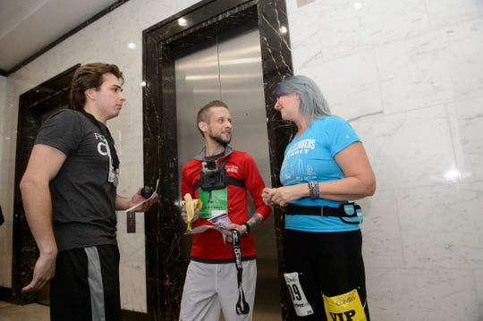 Kyle Bailey of Port Huron talks with fellow climbers  after finishing the American Lung Association's Fight for Air Climb on Sunday at Ally Detroit Center in downtown Detroit. Bailey is a quadruple organ transplant recipient.