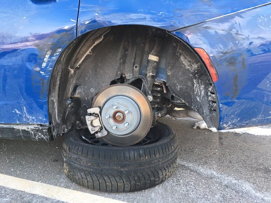 Damage to the tire of a Michigan State Police trooper's car responding to a crash scene after it was reportedly hit by another driver.