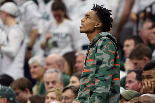 Emoni Bates, the No. 1 basketball recruit in the 2022 class out of Ypsilanti Lincoln, watches a game between Michigan State and Maryland on Feb. 15, 2020 in East Lansing.