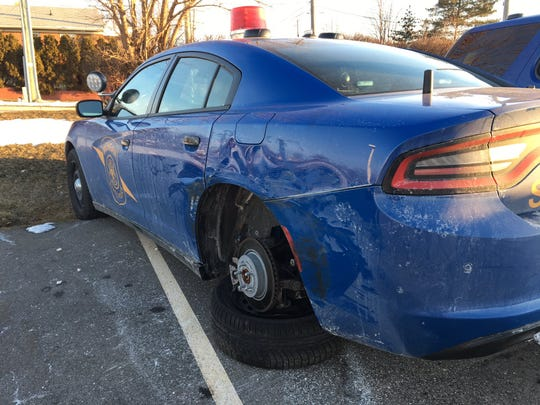 Damage to a Michigan State Police trooper's car responding to a crash scene after it was reportedly hit by another driver.