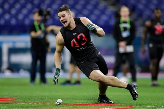 Michigan State defensive lineman Kenny Willekes runs a drill at the NFL scouting combine in Indianapolis, Saturday, Feb. 29, 2020.