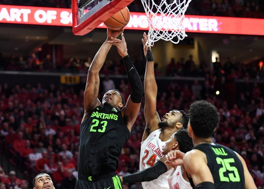 Michigan State forward Xavier Tillman Sr. goes to the basket for a layup against Maryland forward Donta Scott during the first half Saturday, Feb. 29, 2020, in College Park, Md.