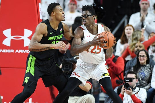Maryland forward Jalen Smith handles the ball against Michigan State forward Xavier Tillman Sr. during the first half Saturday, Feb. 29, 2020, in College Park, Md.