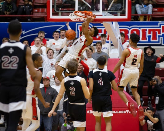 St. Mary's Julian Roper Jr (1) seals the win with a slam dunk in front of U-D Jesuit's JT Morgan (4) during the second half.
