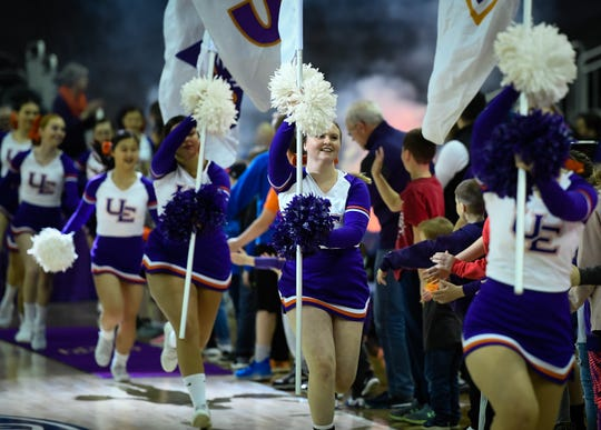 The Aces cheerleaders lead the way as the University of Evansville Purple Aces take the floor for the last home game of the season against Missouri Valley Conference opponent the Illinois State Redbirds at the Evansville Ford Center Saturday, February 29, 2020.