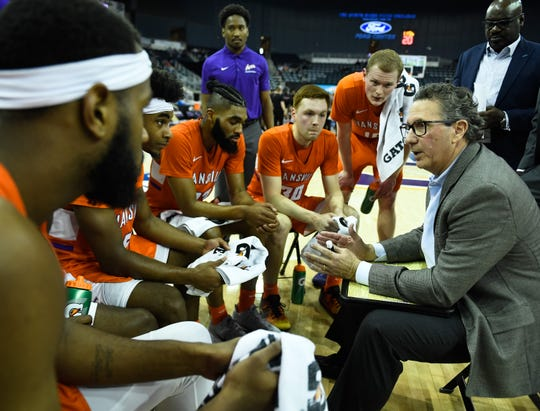 Evansville's head coach Todd Lickliter talks to his team during a second half timeout as the University of Evansville Purple Aces play their last home game of the season against Missouri Valley Conference opponent the Illinois State Redbirds at the Evansville Ford Center Saturday, February 29, 2020.