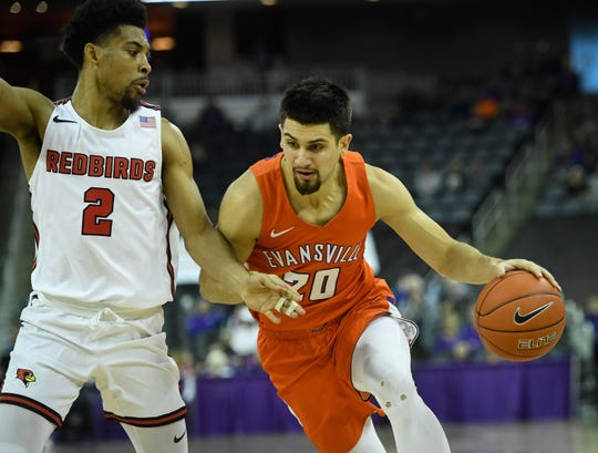 Evansville's Sam Cunliffe (20) drives against Illinois State's Zach Copeland (2) as the University of Evansville Purple Aces play their last home game of the season against Missouri Valley Conference opponent the Illinois State Redbirds at the Evansville Ford Center Saturday, February 29, 2020.