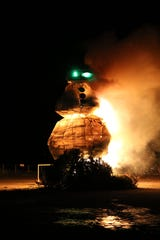 """The Burning Snowman Festival 2020, held at Waterworks Park in Port Clinton on Saturday, included the burning of """"Tim,"""" the sixth snowman in the festival series. The 40-foot-tall snowman was made up of old Christmas trees and covered with white sheets coated in Crisco and candle wax."""