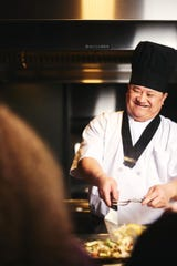 An Osaka chef prepares food for guests hibachi-style on a large flattop grill on Tuesday, February 25, 2020.