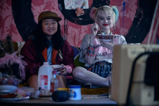 "Cassandra (Ella Jay Basco, left) and Harley (Margot Robbie) are breakfast-cereal pals in ""Birds of Prey (And the Fantabulous Emancipation of One Harley Quinn)."""