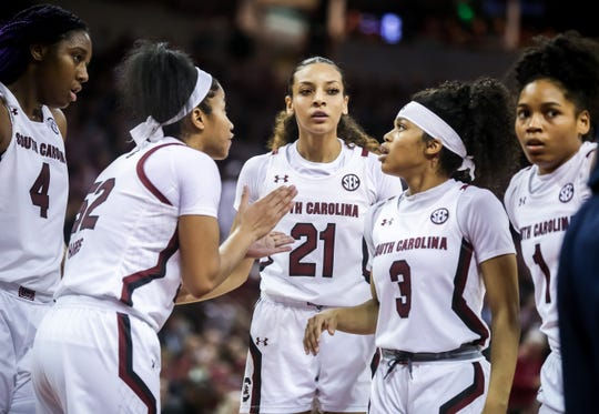 Feb 10, 2020; Columbia, South Carolina, USA; South Carolina Gamecocks guard Tyasha Harris (52) speaks with South Carolina Gamecocks forward Aliyah Boston (4) and South Carolina Gamecocks forward Mikiah Herbert Harrigan (21) and South Carolina Gamecocks guard Destanni Henderson (3) and South Carolina Gamecocks guard Zia Cooke (1) against the UConn Huskies in the second half at Colonial Life Arena. Mandatory Credit: Jeff Blake-USA TODAY Sports
