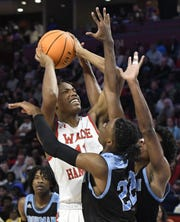 Wade Hampton's Saiyd Burnside (11) tries to shoot over a pair of Dorman defenders in the Class AAAAA Upper State championship Saturday at the Bon Secours Wellness Arena in downtown Greenville.