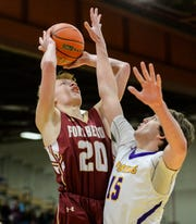 Fort Benton's Hayden Diekhans attempts a shot over Big Sandy's Clint Darlington during the championship game of the Northern C Divisional Basketball Tournament on Saturday in the Four Seasons Arena.