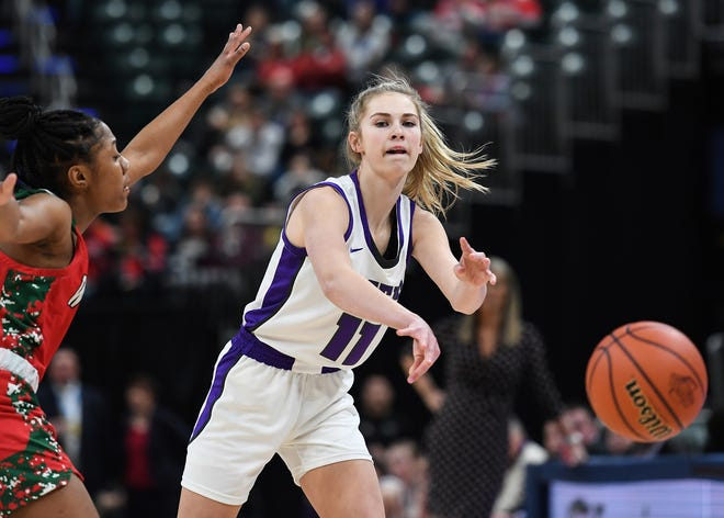 Northwestern Tigers McKenna Layden (11) passes the ball against Lawrence North Wildcats defense in the second half of the Class 4A state final game at Bankers Life Fieldhouse on Saturday, Feb. 28, 2020. The Lawrence North Wildcats defeated the Northwestern Tigers 59-56.