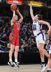 Lawrence North Wildcats Katie Davidson (12) sinks a jumper against Northwestern Tigers Kendall Bostic (44) in the second half of the Class 4A state final game at Bankers Life Fieldhouse on Saturday, Feb. 28, 2020. The Lawrence North Wildcats defeated the Northwestern Tigers 59-56.