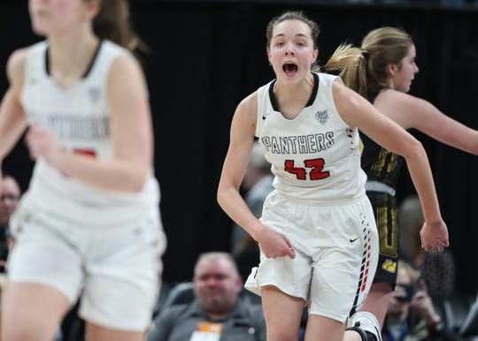 NorthWood Panthers Maddy Payne (42) celebrates a lay-up against the Salem Lions in the second half of the Class 3A state final game at Bankers Life Fieldhouse on Saturday, Feb. 28, 2020. NorthWood Panthers defeated the Salem Lions 37-29.