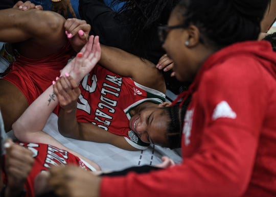 Lawrence North Wildcats Jayla Smith (24) and her teammates celebrate their title after defeating the Northwestern Tigers in the Class 4A state final game at Bankers Life Fieldhouse on Saturday, Feb. 28, 2020. The Lawrence North Wildcats defeated the Northwestern Tigers 59-56.