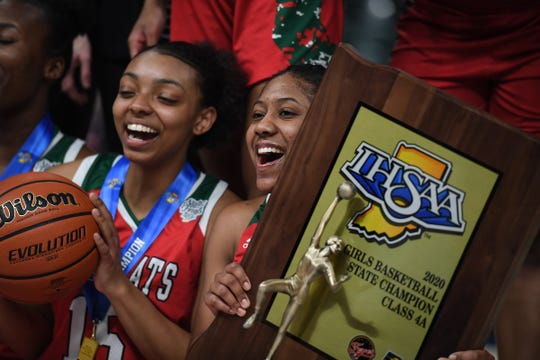 Lawrence North Wildcats celebrate their title after defeating the Northwestern Tigers in the Class 4A state final game at Bankers Life Fieldhouse on Saturday, Feb. 28, 2020. The Lawrence North Wildcats defeated the Northwestern Tigers 59-56.