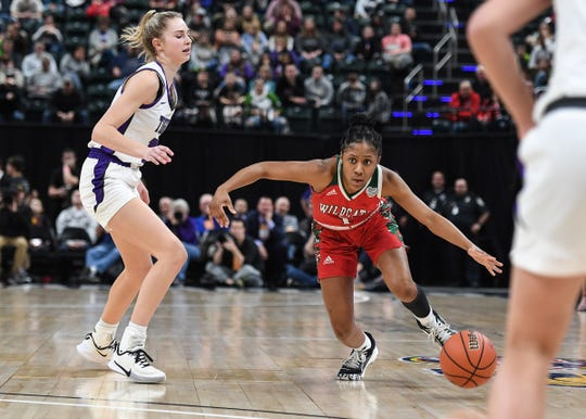 Lawrence North Wildcats Kristian Young (1) drives the ball against the Northwestern Tigers in the second half of the Class 4A state final game at Bankers Life Fieldhouse on Saturday, Feb. 28, 2020. The Lawrence North Wildcats defeated the Northwestern Tigers 59-56.
