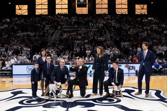 The Butler Bulldog collar is passed from Blue III to Blue IV, the new Butler Bulldog Mascot, during the passing of the collar ceremony before the men's basketball game at Hinkle Fieldhouse in Indianapolis, Saturday, Feb. 29, 2020. Butler defeated DePaul 60-42. Kaiti Sullivan/for IndyStar