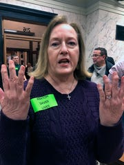 In this Thursday, Feb. 27, 2020, photo, Kathy Joiner says she uses a drug called kratom to ease the pain of arthritis at the Mississippi Capitol in Jackson, Miss. Joiner is a resident of Brandon, Miss. She says she opposes any proposal to outlaw kratom in Mississippi.