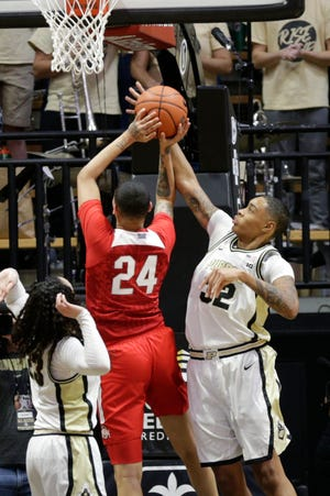 Purdue forward Ae'Rianna Harris (32) blocks Ohio State guard Kierstan Bell (24)'s shot during the fourth quarter of a NCAA women's basketball game, Saturday, Feb. 29, 2020 at Mackey Arena in West Lafayette.