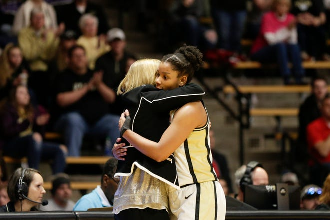 Purdue head coach Sharon Versyp and Purdue guard Dominique Oden (11) embrace during the fourth quarter of a NCAA women's basketball game, Saturday, Feb. 29, 2020 at Mackey Arena in West Lafayette.