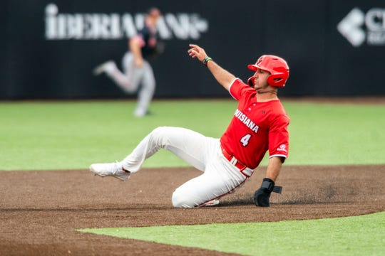 """UL's Brennan Breaux slides onto second base as the Ragin' Cajuns defeat the Sam Houston Bearkats 7-5 at M.L. Tigue """"Moore"""" Field on Sunday, March 1, 2020."""