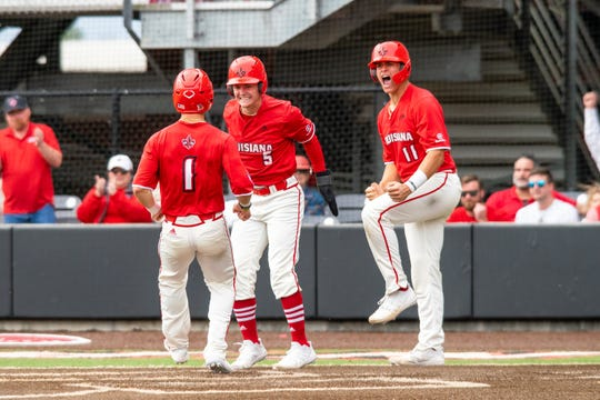 UL's Connor Dupoy (1) is greeted by Hayden Cantrelle (5) and Julian Brock (11) after all three scored on Gavin Bourgeois' tying double in the fourth inning of a 7-5 win over Sam Houston State on Sunday at The Tigue.