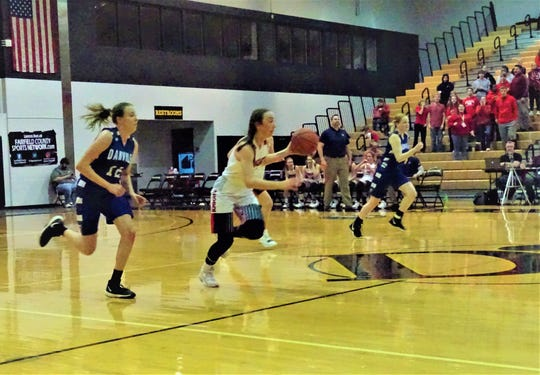 Fairfield Christian Academy senior Hope Custer brings the ball up the court during the Knights' 50-42 district final loss against Danville on Saturday.
