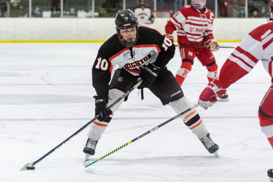 Brighton's Will Jentz carries the puck in a 3-2 regional semifinal victory over Orchard Lake St. Mary's on Saturday, Feb. 29, 2020.